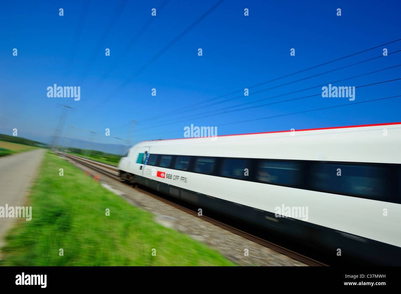 A Swiss train. Motion blur used to give sense of speed. Focus on the CFF logo - Stock Image