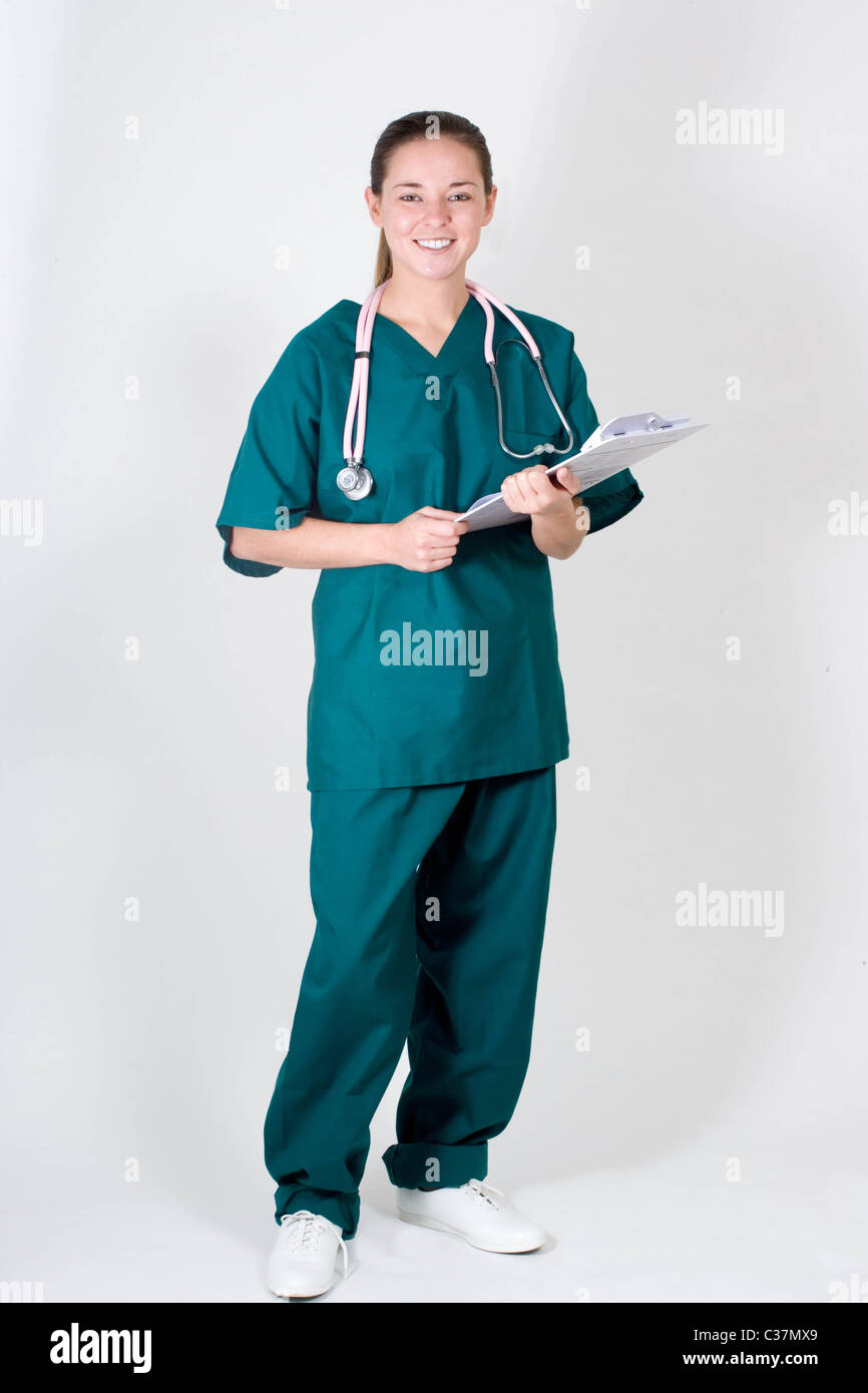 Portrait of young nurse in scrubs, full body - Stock Image