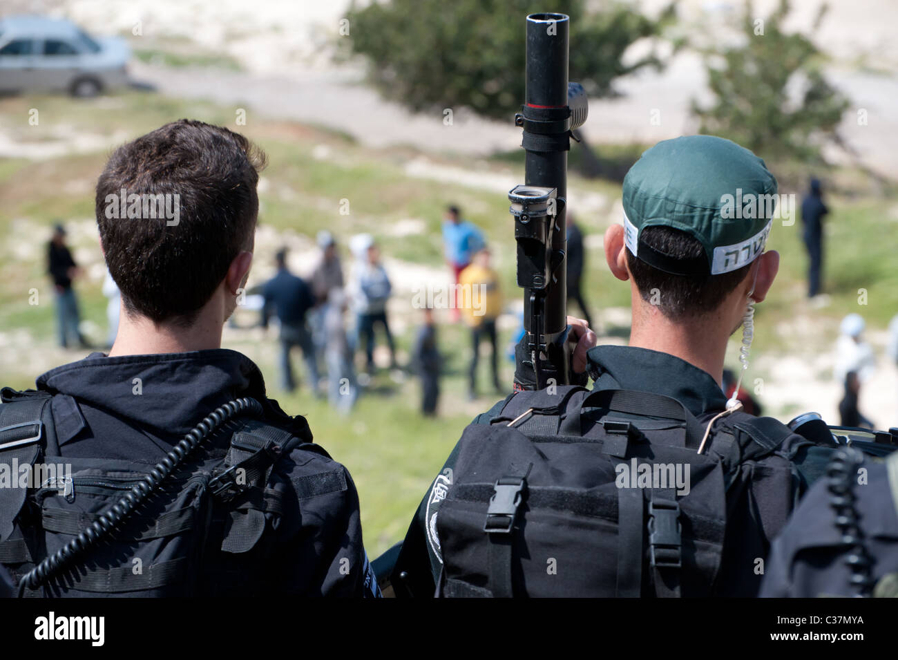 Israeli riot police wield tear gas guns during clashes with Palestinian youth in the East Jerusalem neighborhood - Stock Image