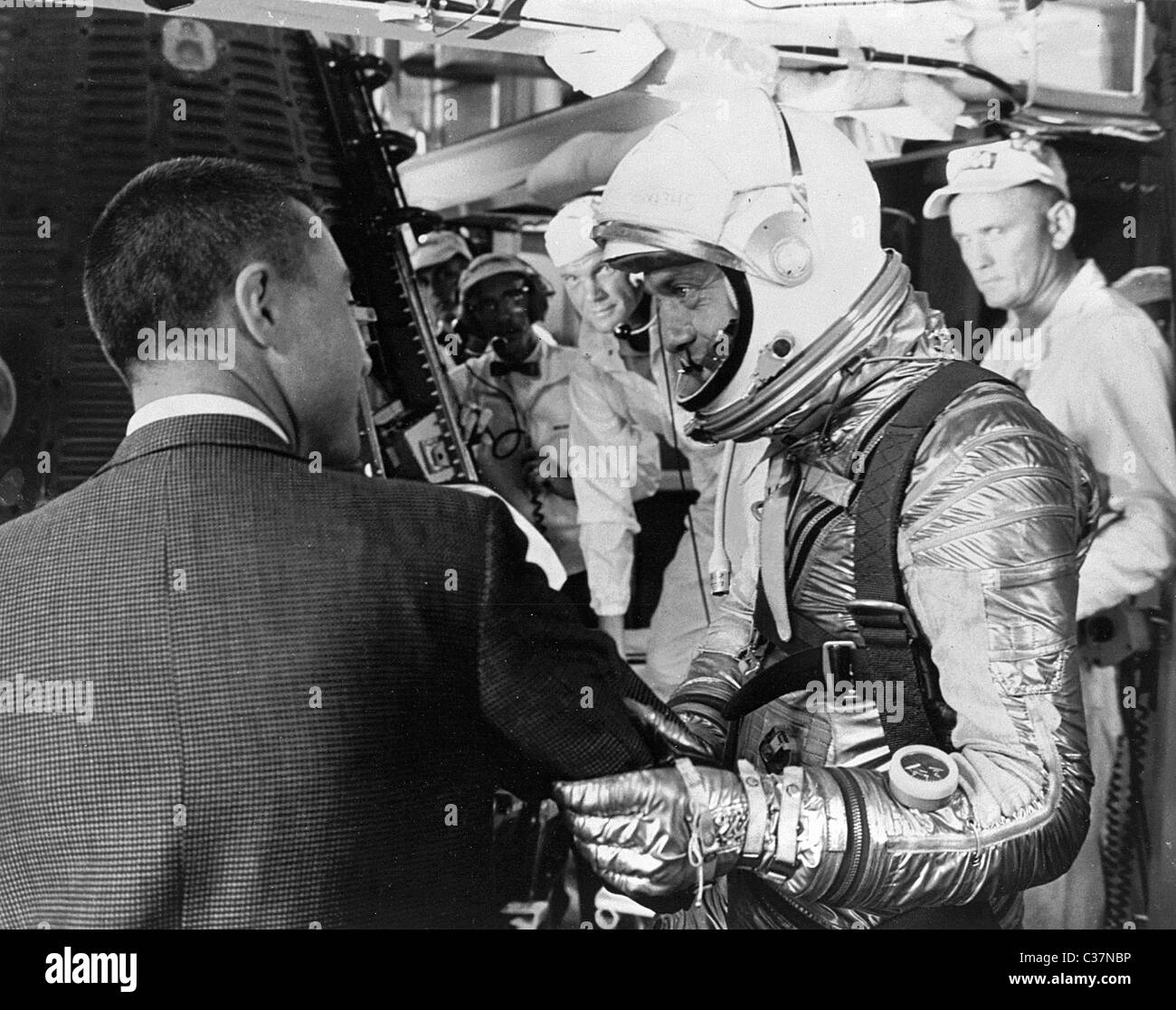 Mercury astronaut Gus Grissom wishes Alan Shepard good luck as he gets into his Mercury capsule, dubbed Freedom Stock Photo