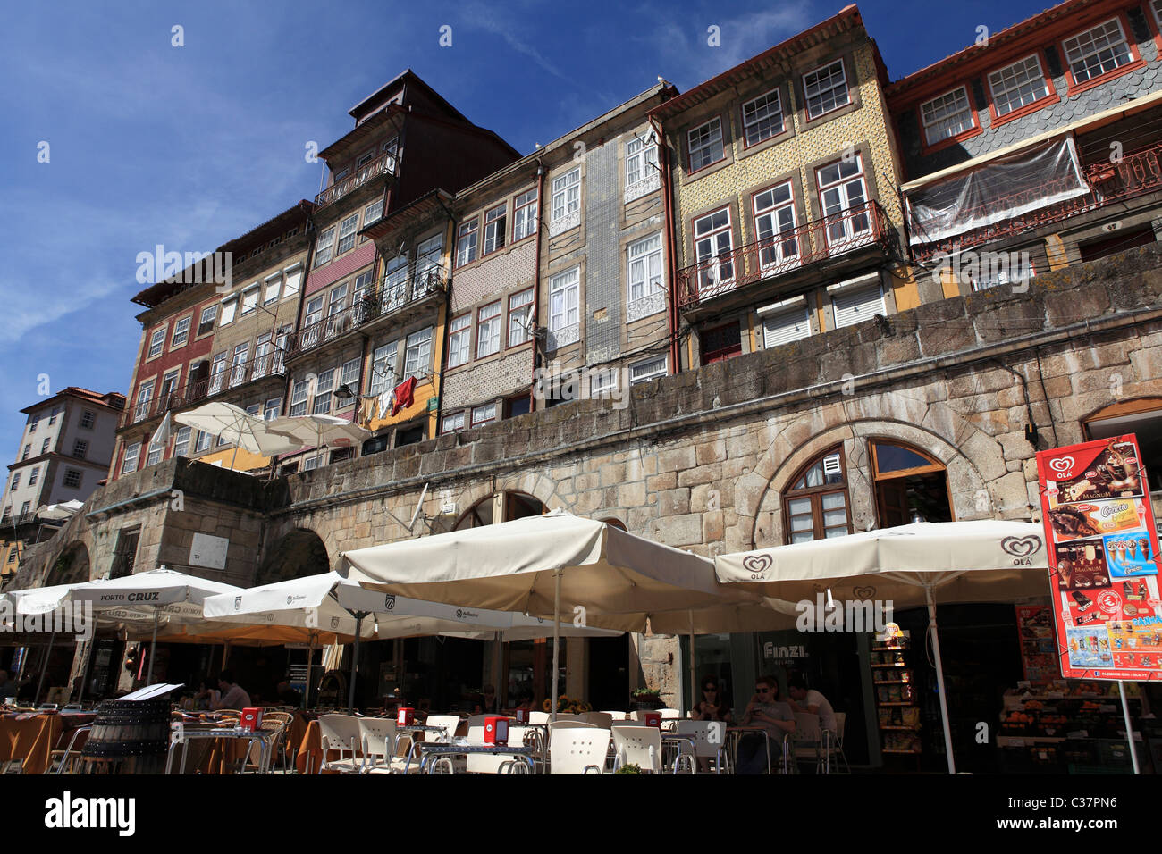 Cafes and restaurants on the riverside Riberia district of Porto, Portugal. - Stock Image