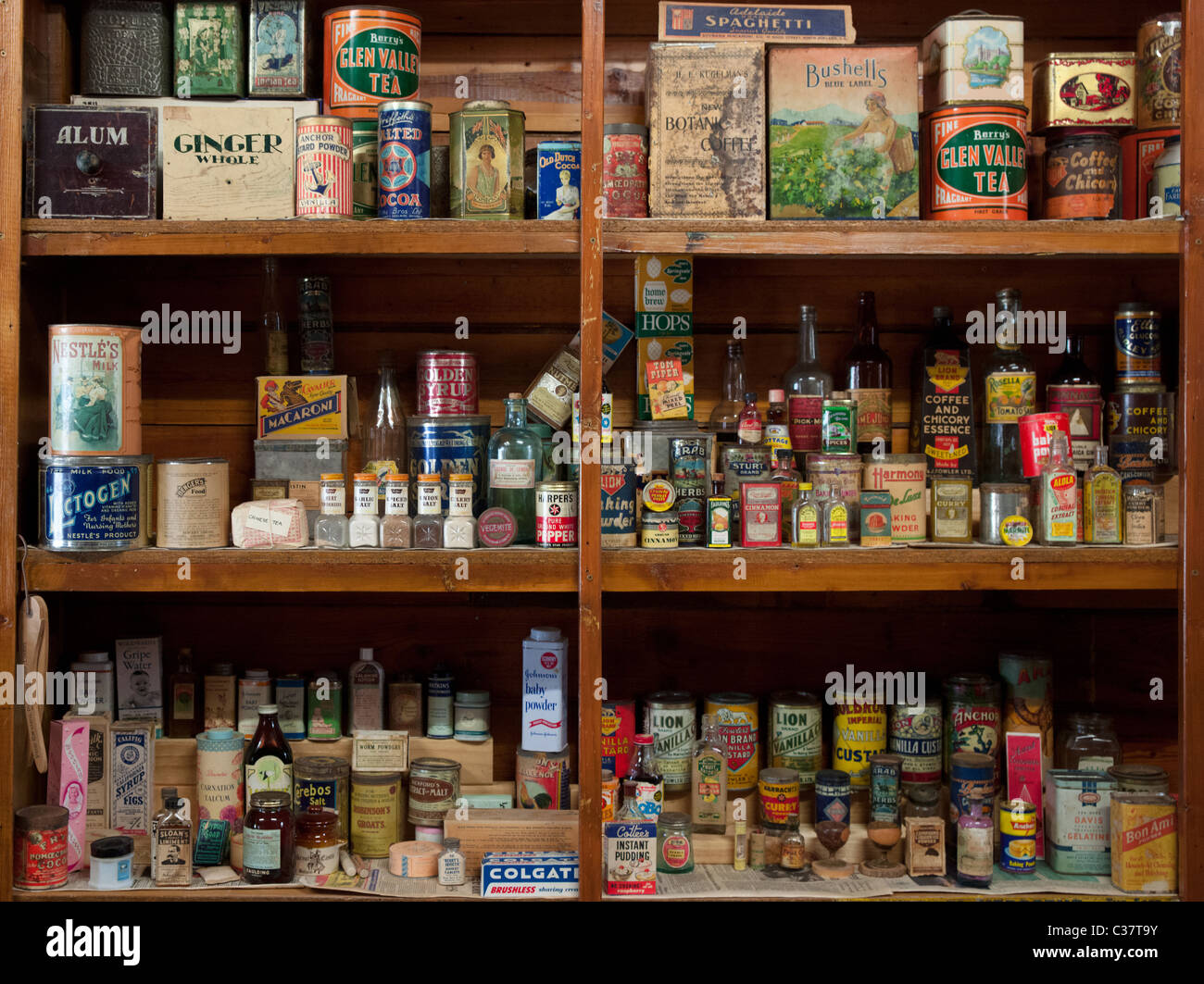 an old shelf full of vintage food supplies found in an old general stock photo 36437463 alamy. Black Bedroom Furniture Sets. Home Design Ideas