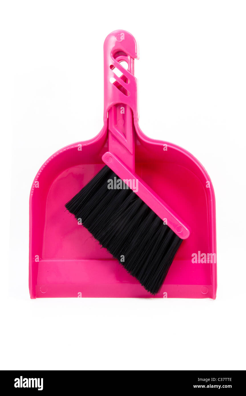 Pink dust pan and brush - Stock Image