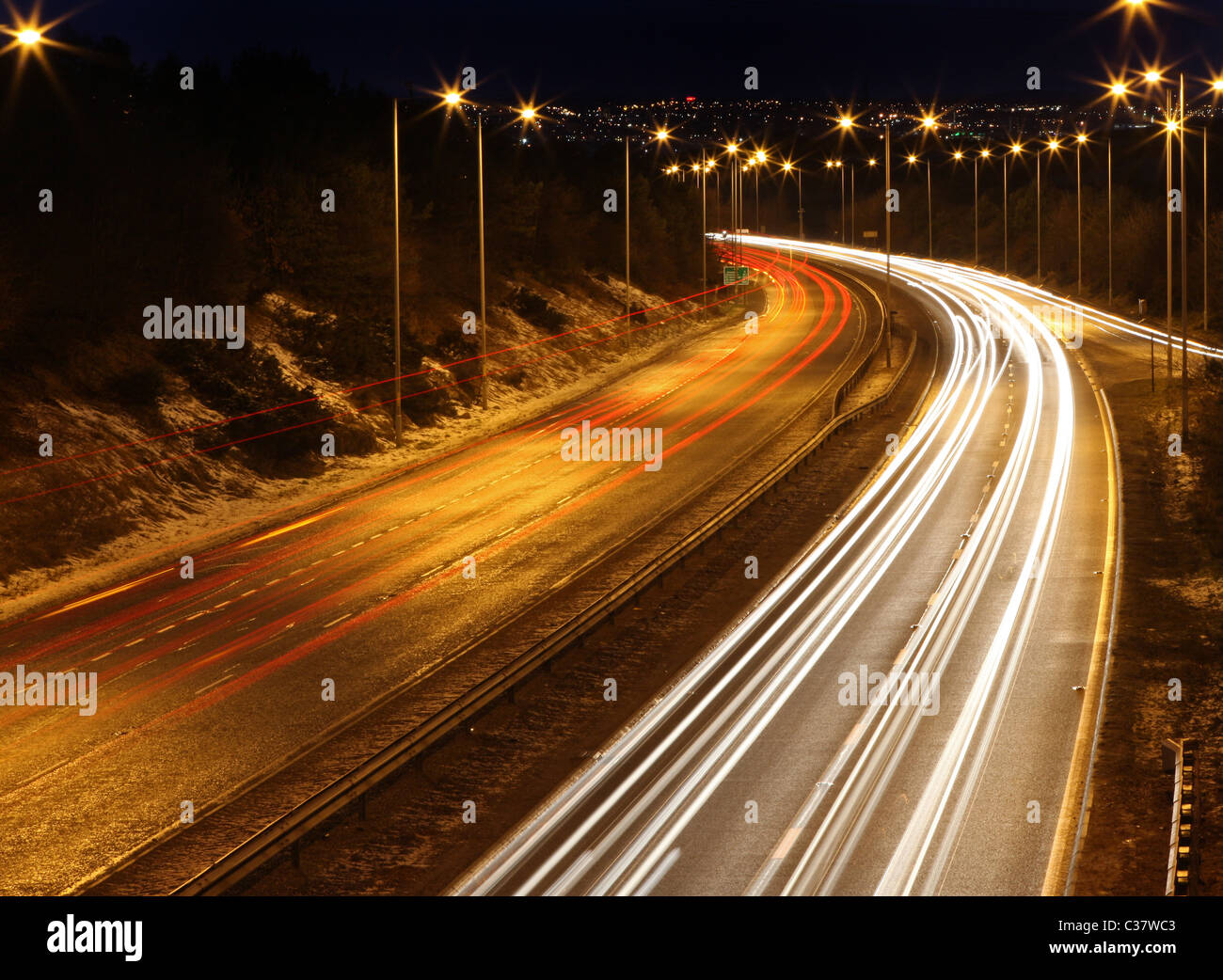 Traffic light trails seen at night on the busy A90 dual carriageway leading in to the city of Aberdeen, Scotland, - Stock Image