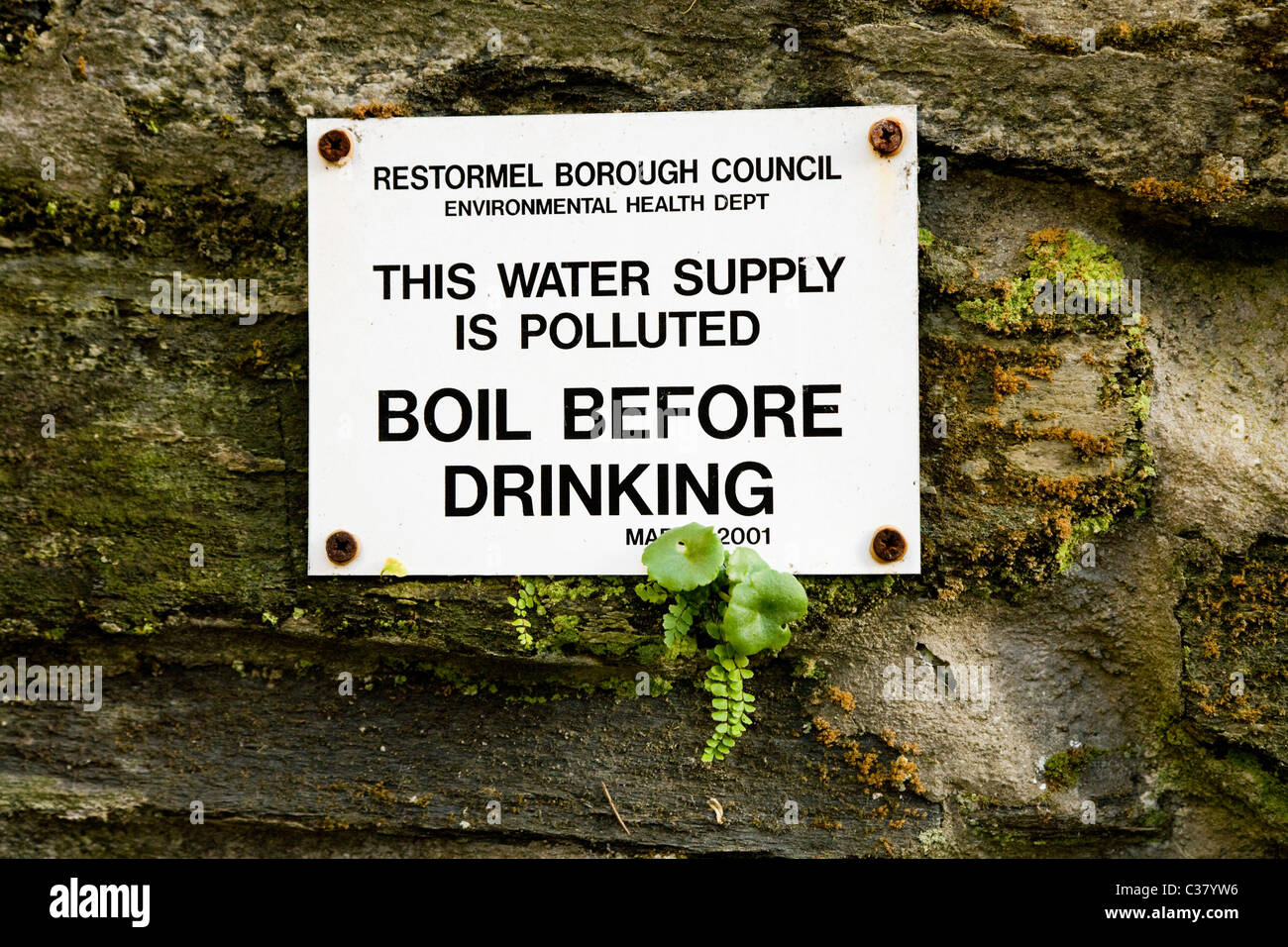 Warning sign by underground natural Cornish spa / spring / mineral water ground source in Lostwithiel, Cornwall. - Stock Image