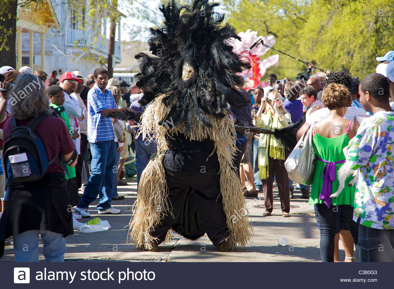 A Mardi Gras Indian wearing traditional hand-made costume sewn from feathers and beads, New Orleans, Louisiana - Stock Image
