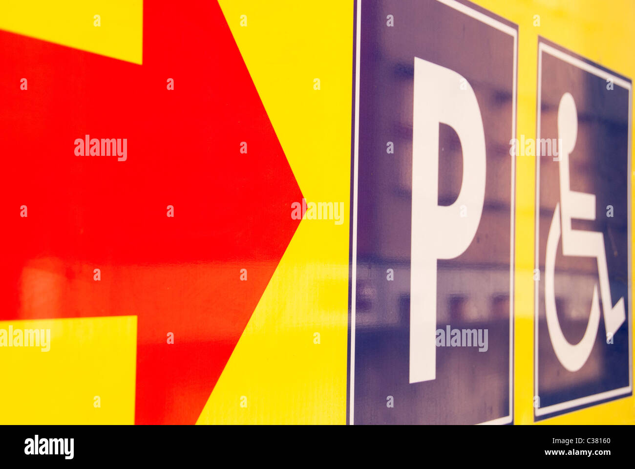 indication for parking and disabled people spots - Stock Image