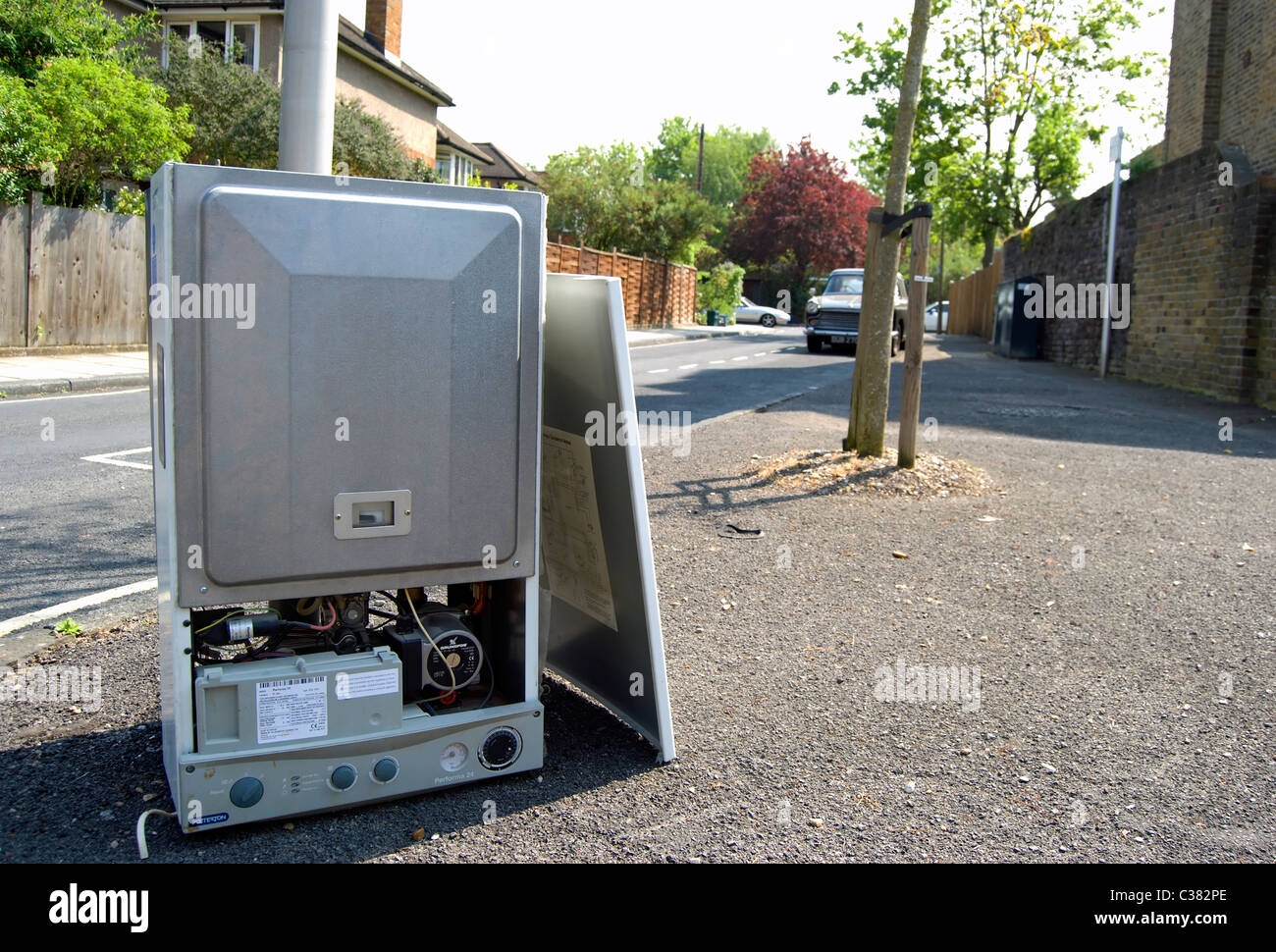 domestic gas boiler dumped in a residential street in twickenham, middlesex, england - Stock Image