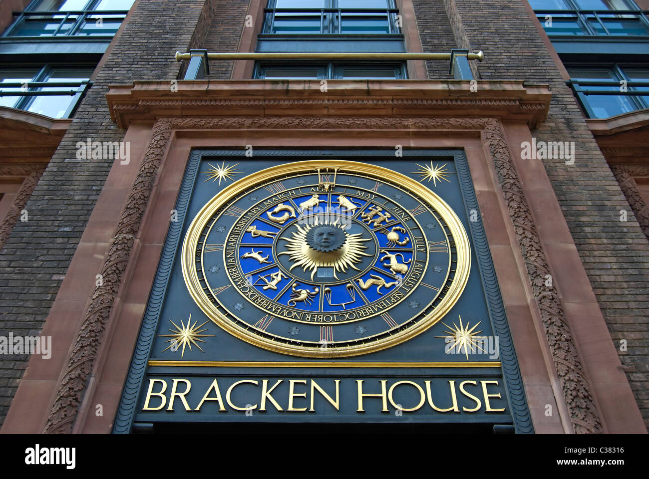 astrological clock above an entrance to bracken house, former home of the financial times, in cannon street, london, - Stock Image
