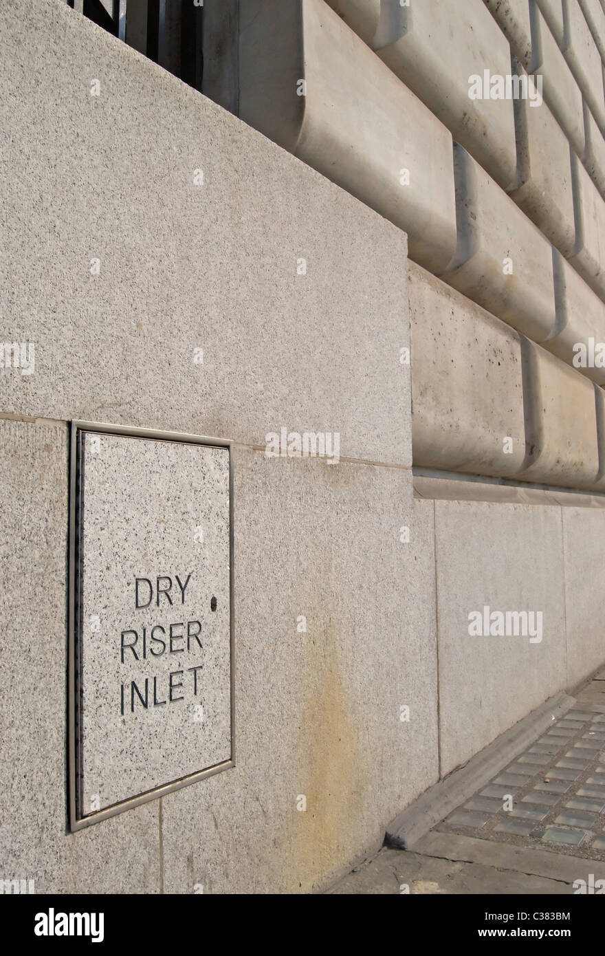 dry riser inlet sign on the front of  unilever house victoria embankment, london, england - Stock Image