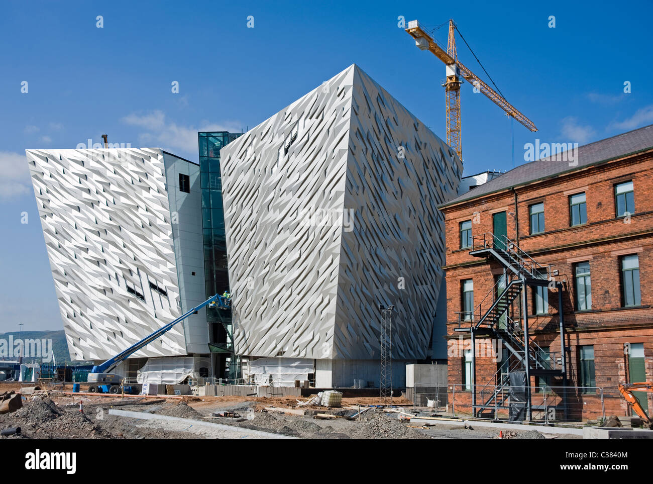 The new Titanic Museum under construction in Belfast, the original Titanic drawing office is on the right. - Stock Image