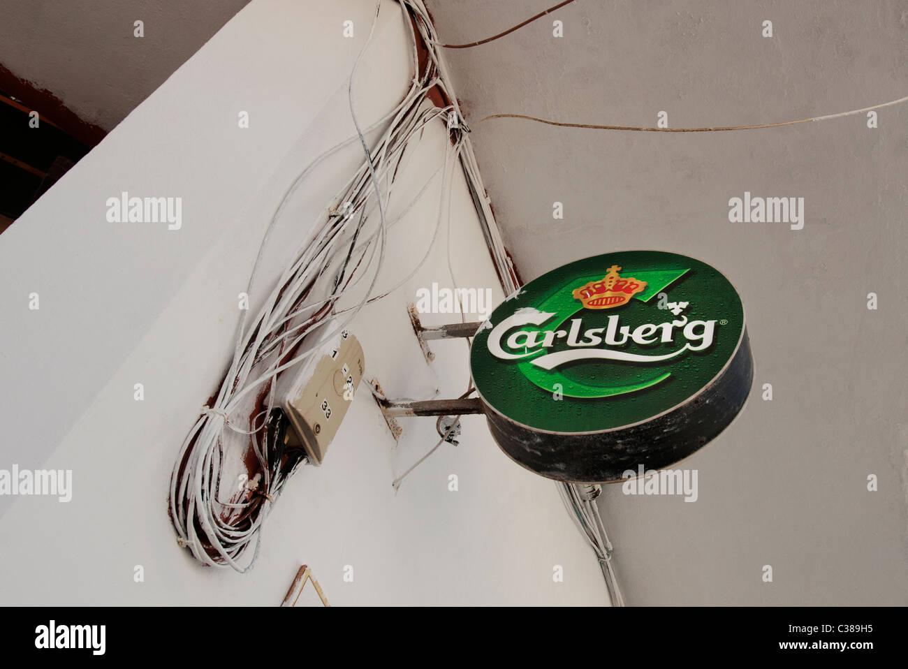 Carlsberg beer sign on the wall outside bar Fuerteventura Canary Islands - Stock Image