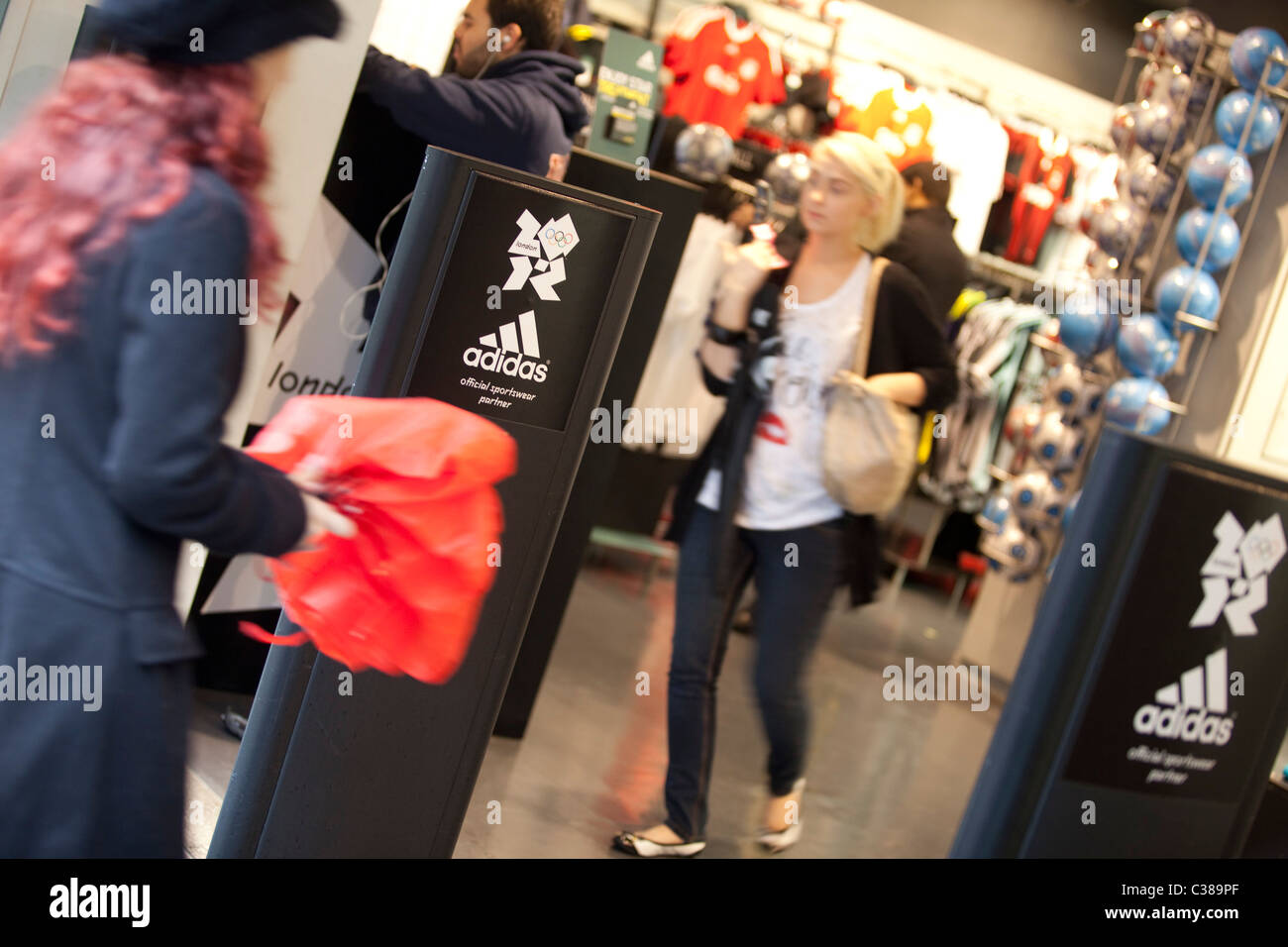 The entrance to an Adidas store in Central London. - Stock Image