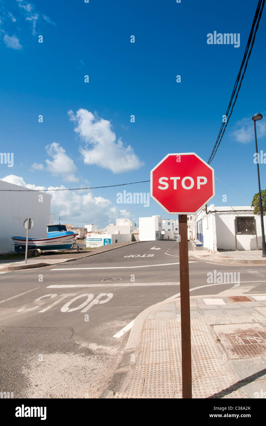 Road junction with red stop sign Fuerteventura Canary Islands - Stock Image