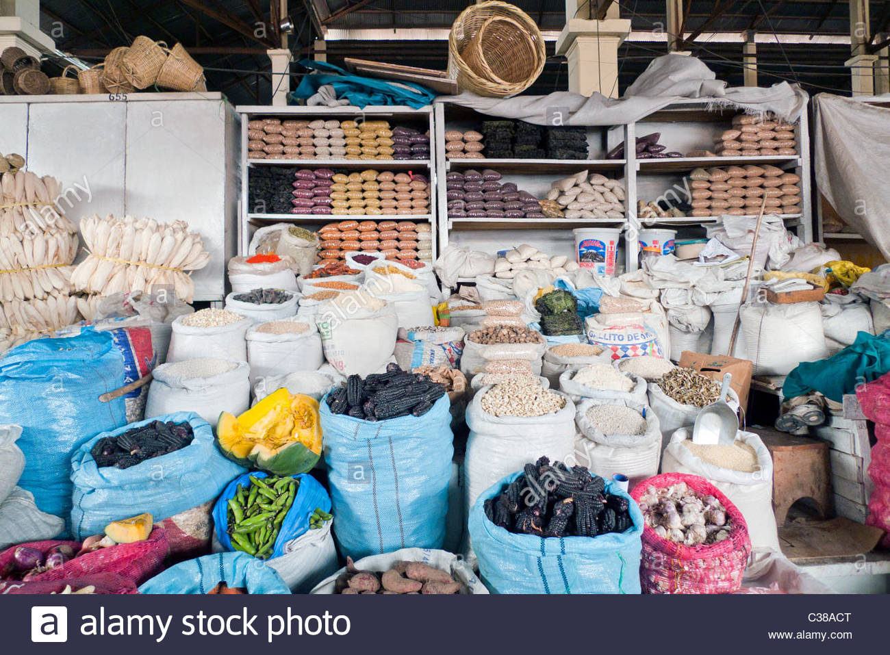 Sacks of corn and grains for sale at a local market. Cusco, Peru. - Stock Image