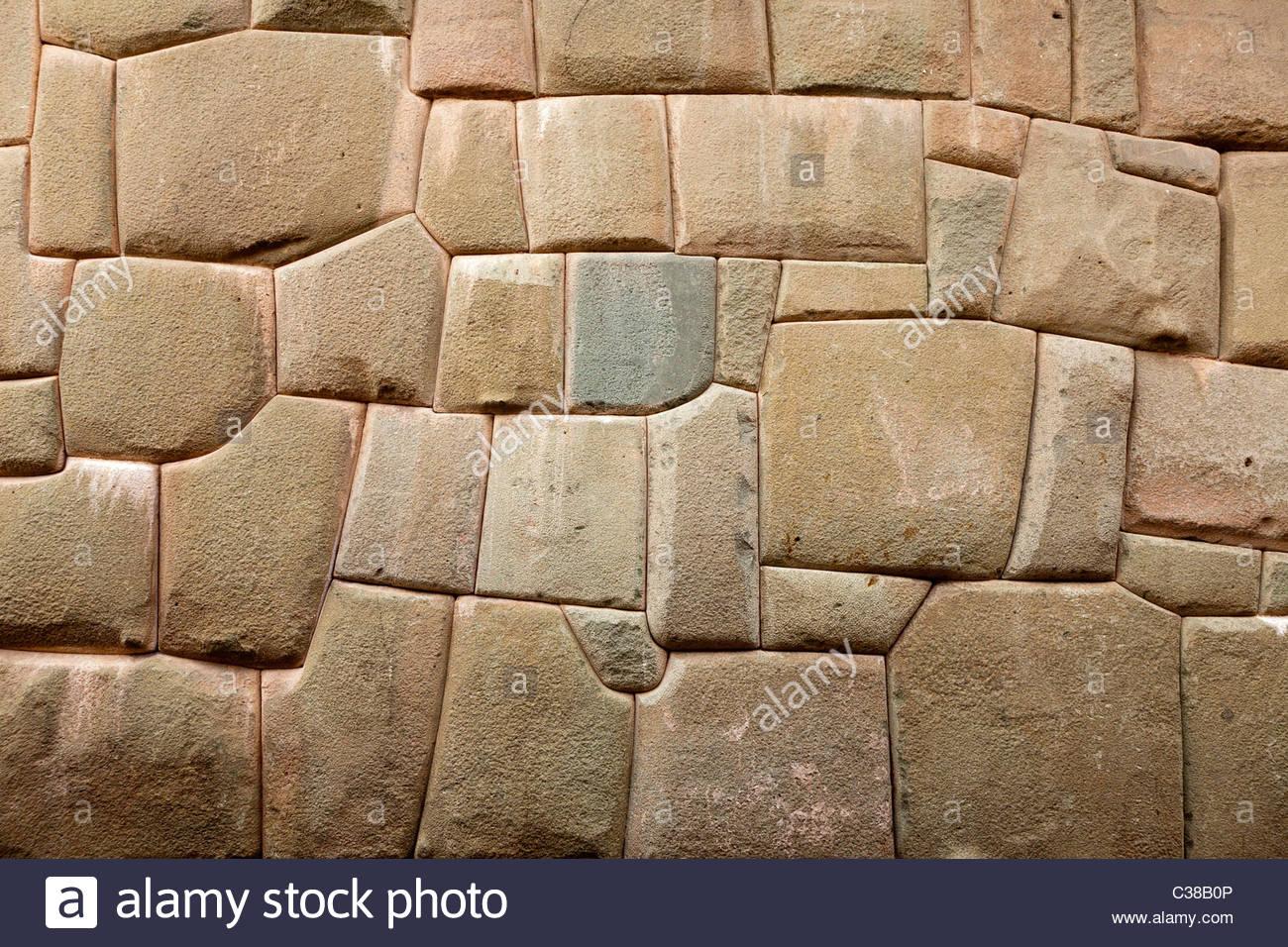 Inca stonework on the ancient palace of Inca Roca, Cusco, Peru. - Stock Image