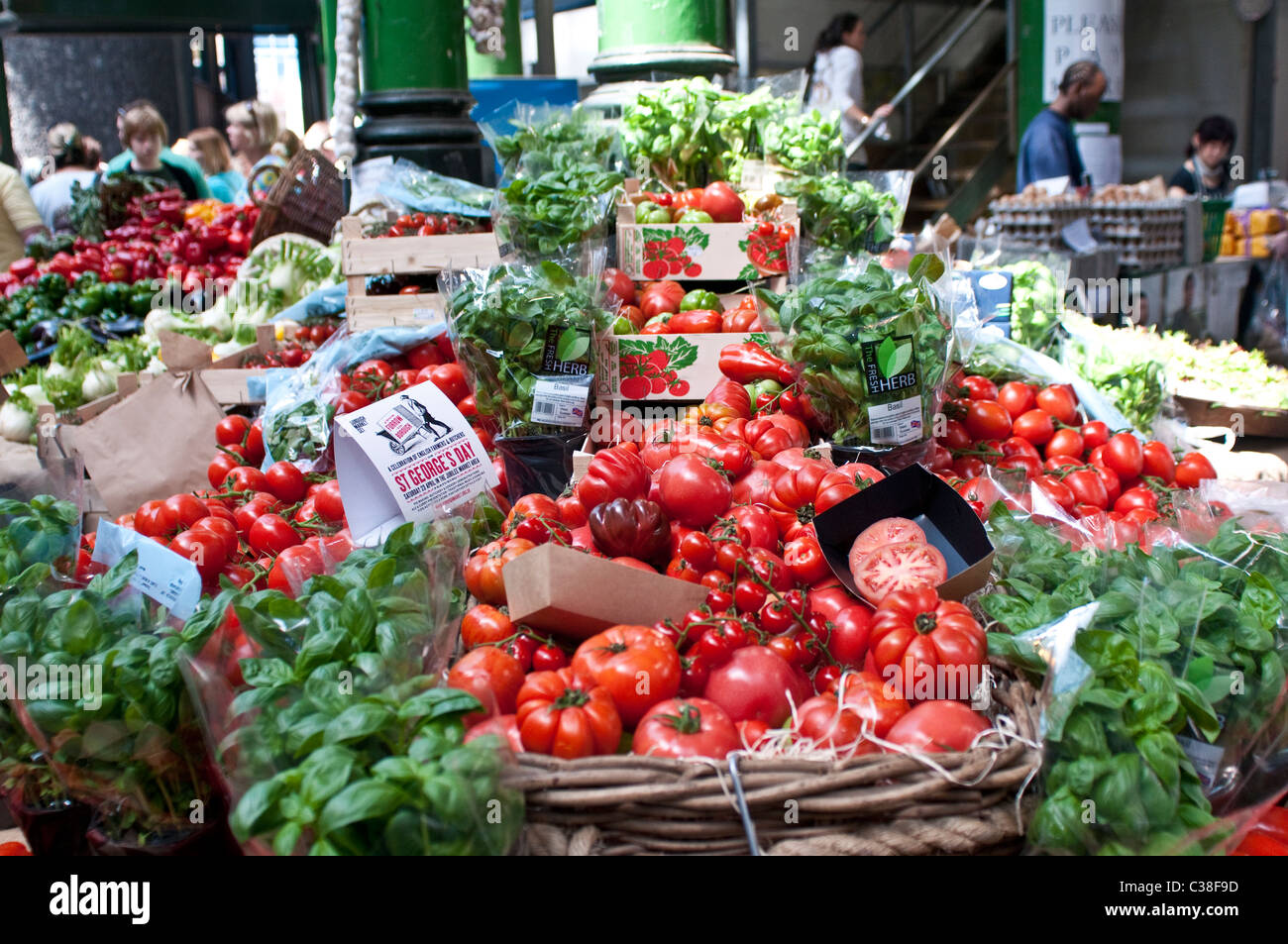 Tomatoes and basil, Borough Market, Southwark, London, UK - Stock Image