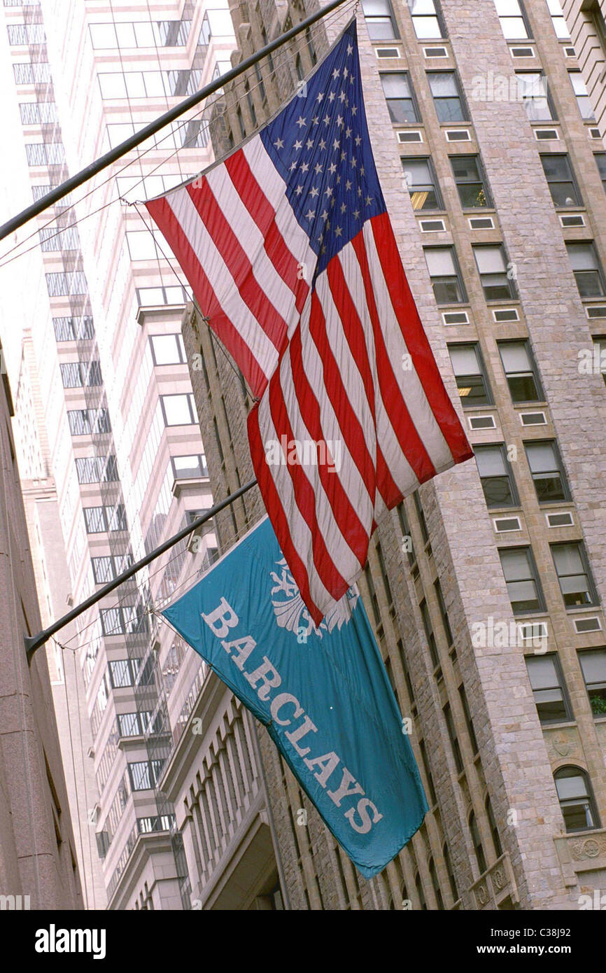 Barclays logo on a flag flying alongside the American flag. Stock Photo