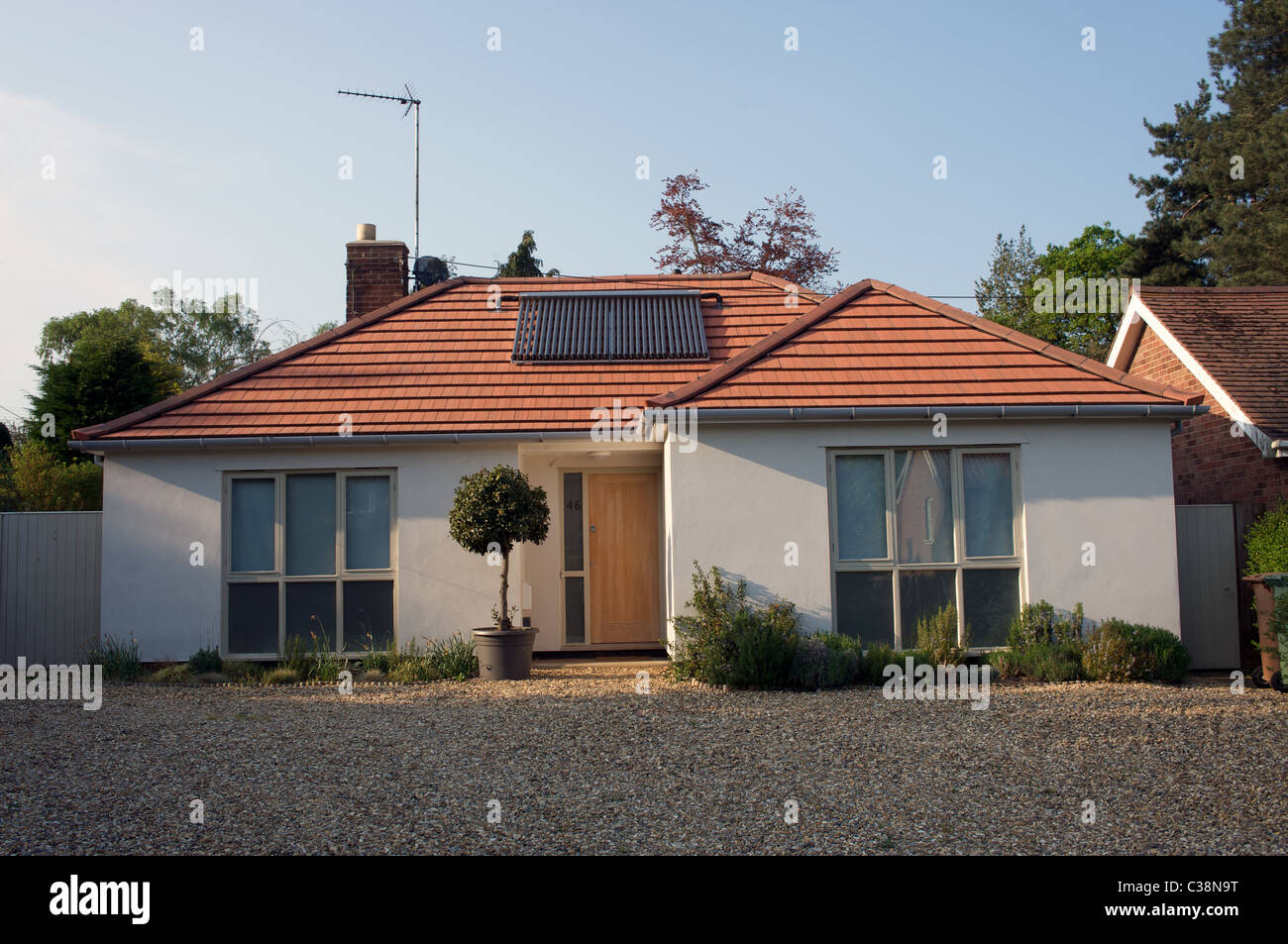 Bungalow fitted with evacuated solar energy tubes for hot water system Stock Photo