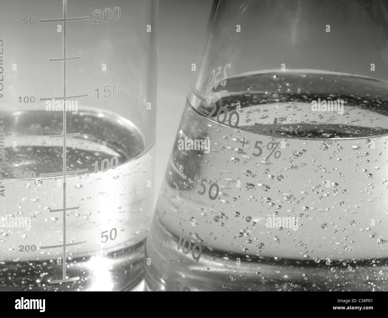 Beakers In Lab With Boiling Liquid & Air Bubbles Stock Photo