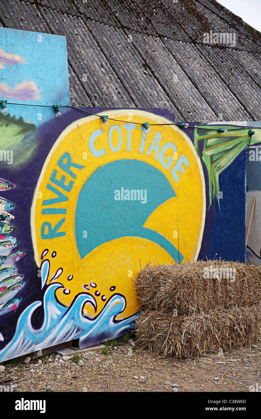 Painting on side of barn at Hugh fearnley whittingstall's park farm,river cottage HQ near Axminster. - Stock Image