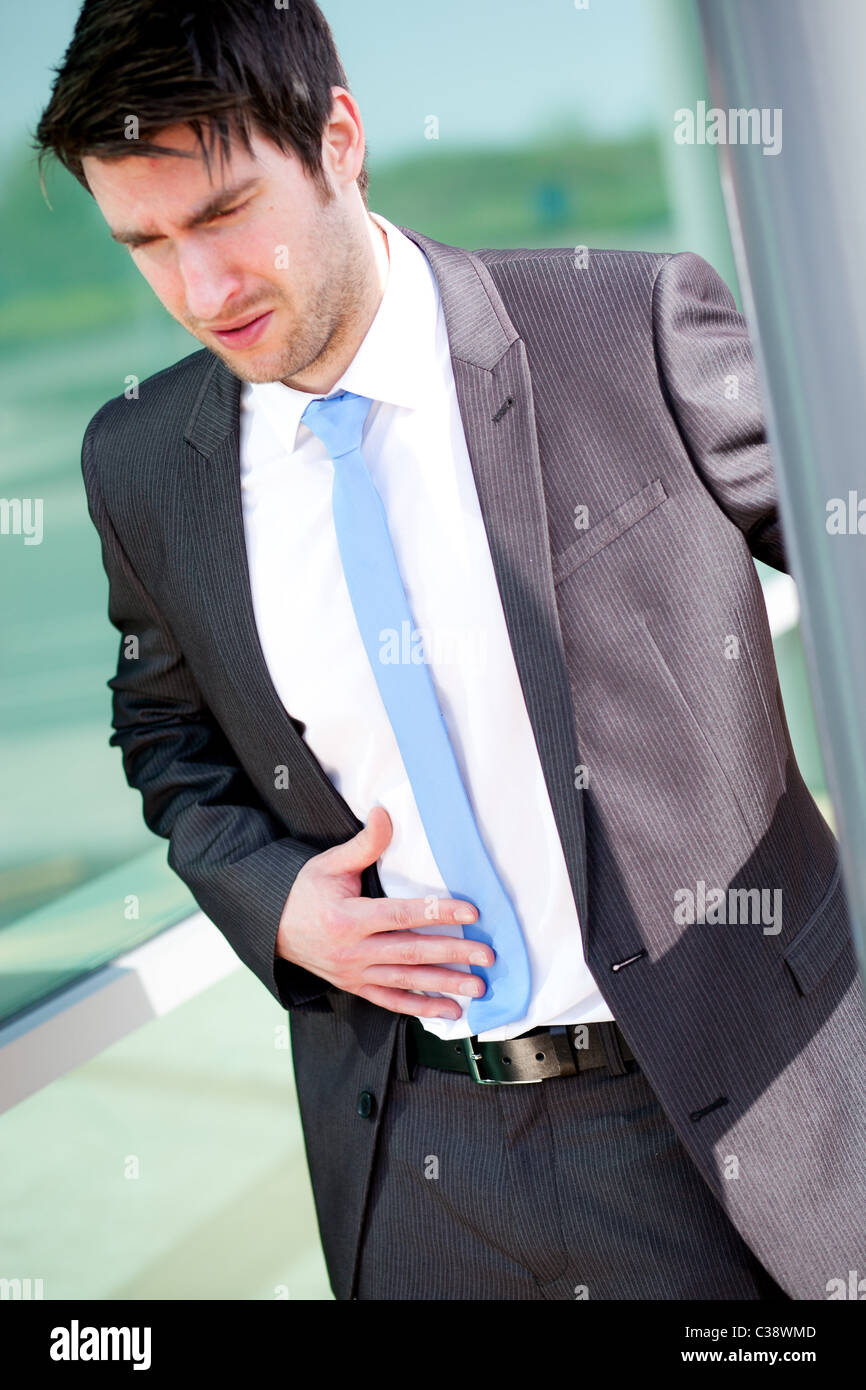 Man with stomach ache - Stock Image