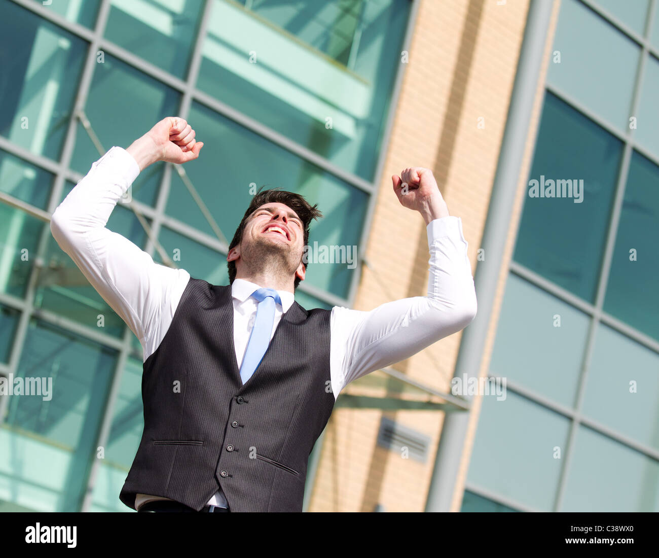 Man with arms in the air - Stock Image