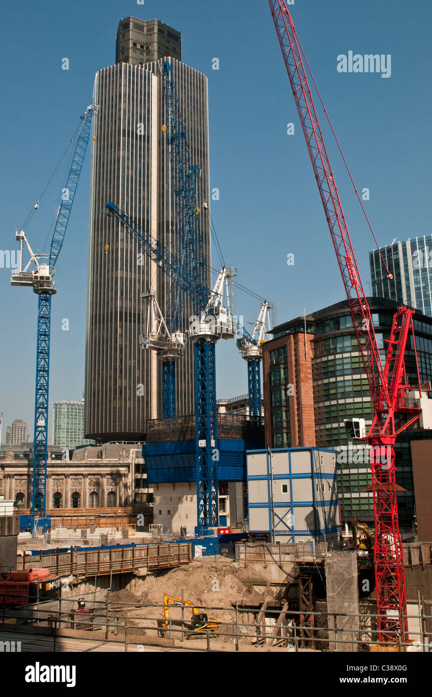 The Pinnacle building site and Tower 42, NatWest tower in the background, City of London, UK - Stock Image