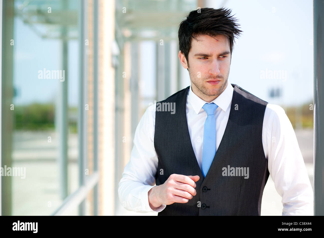 Man stood outside office - Stock Image