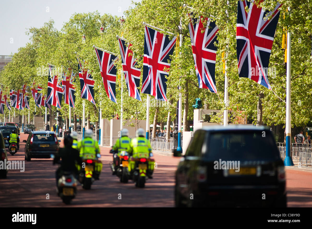 View of The Mall in central London with Union flags lining the route. - Stock Image