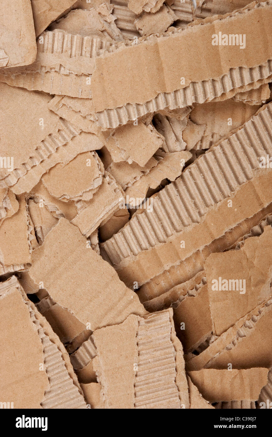 front view of corrugated cardboard torn pile - Stock Image