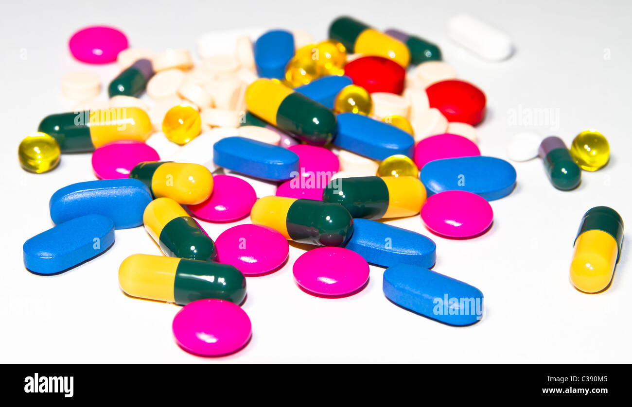 Medical concept, many pills on white background - Stock Image