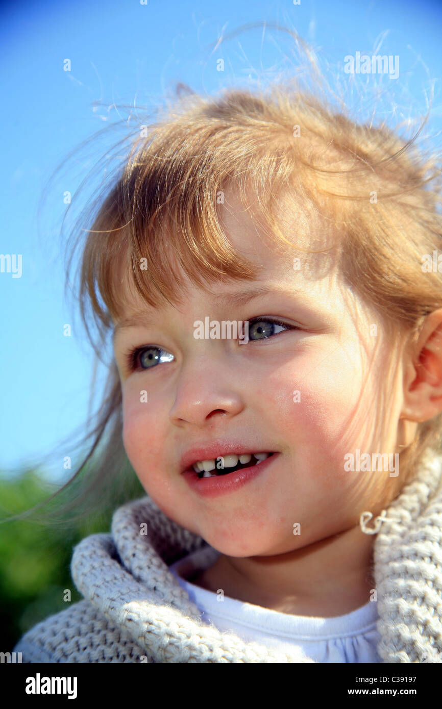 Outdoor portrait of a 4 year old girl. - Stock Image