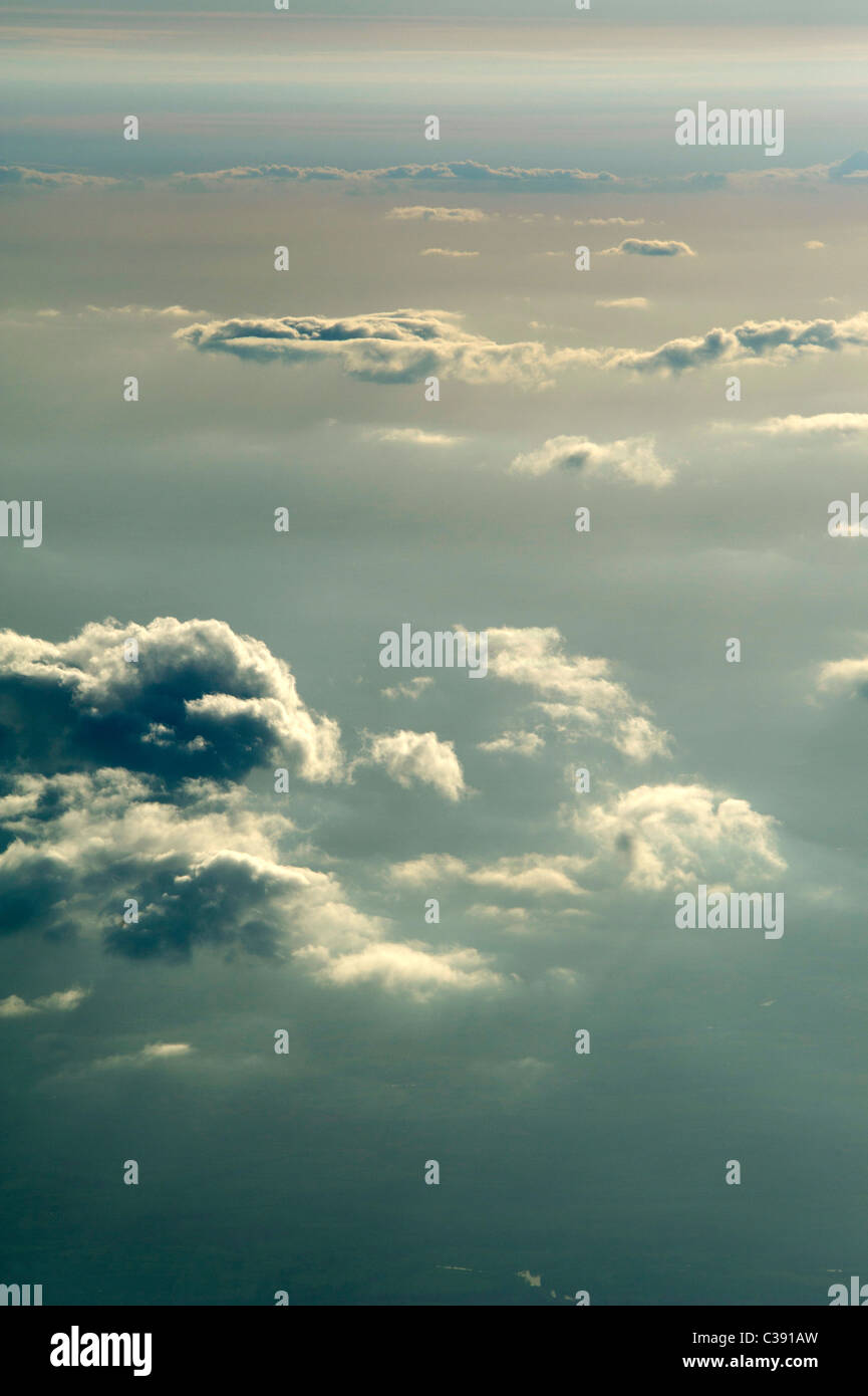 View of clouds from an airplane window - Stock Image