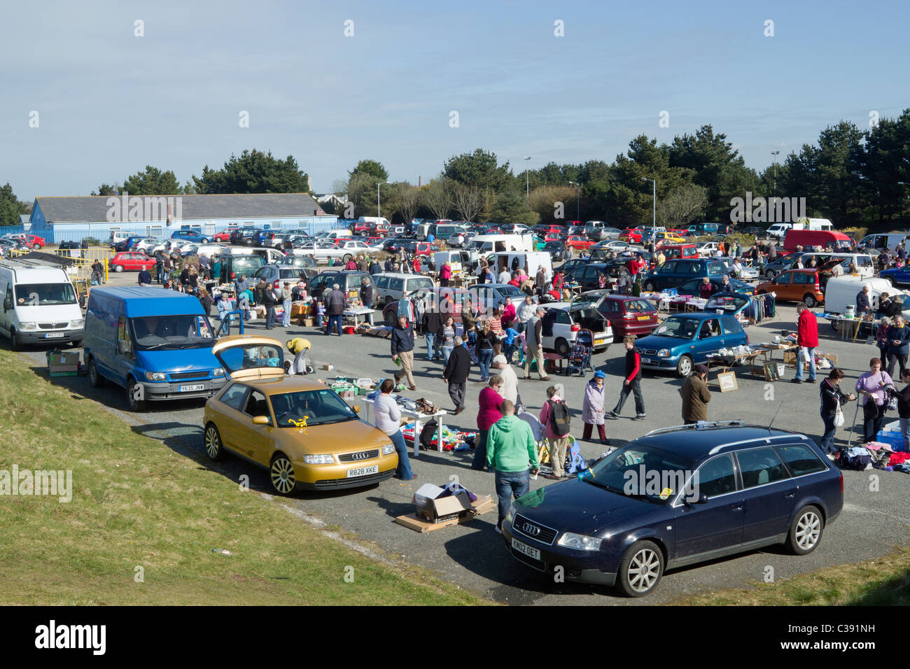A car boot sale at the Carn Brea Leisure Centre car park in Pool near Redruth, Cornwall UK. - Stock Image