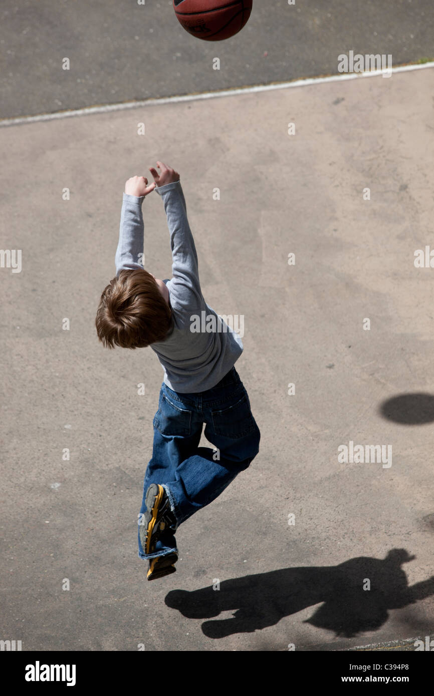 Young boy playing street basketball in Riverside Park, New York City. Stock Photo