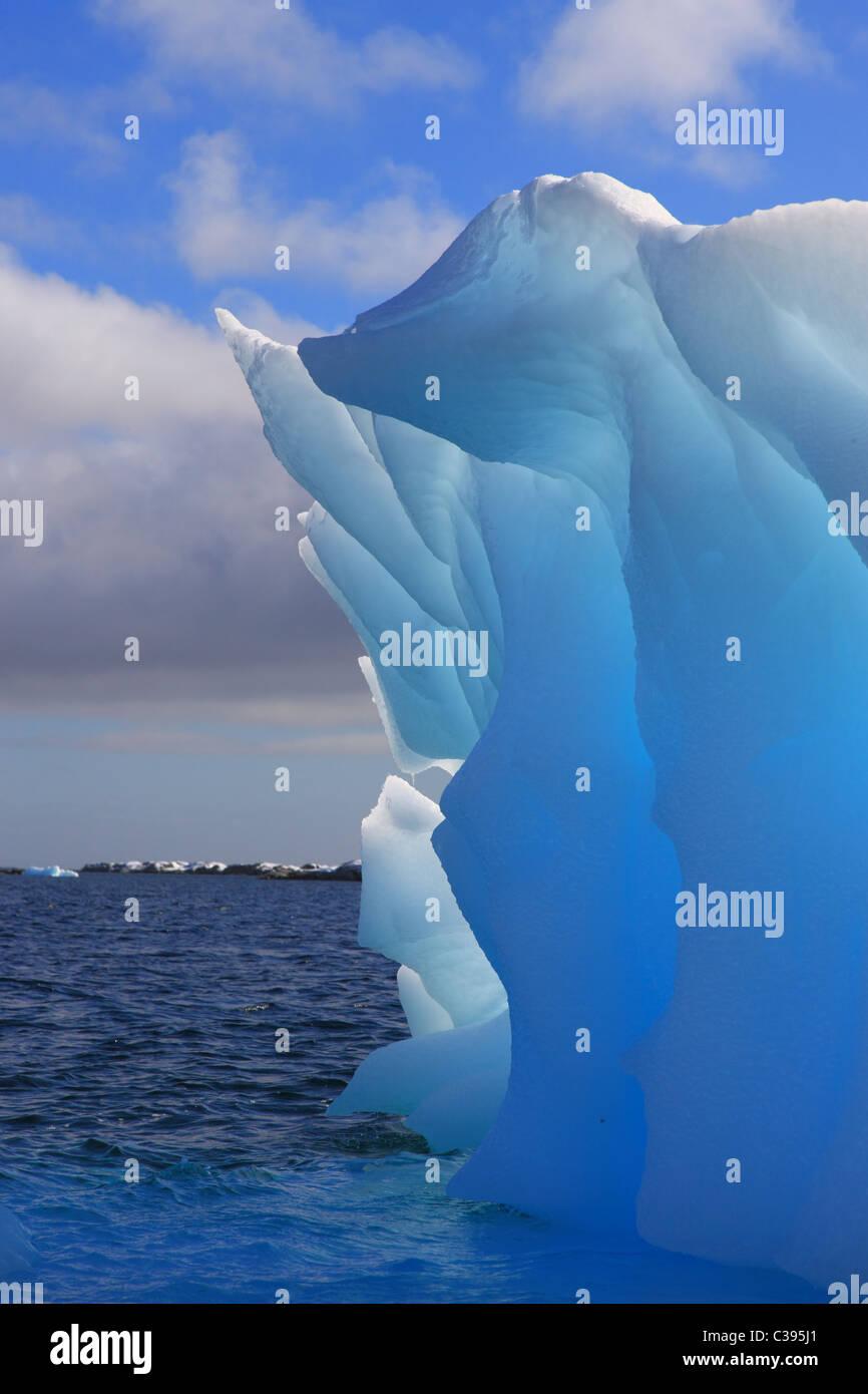Luminescent Iceberg in Antarctica with sunlight - Stock Image