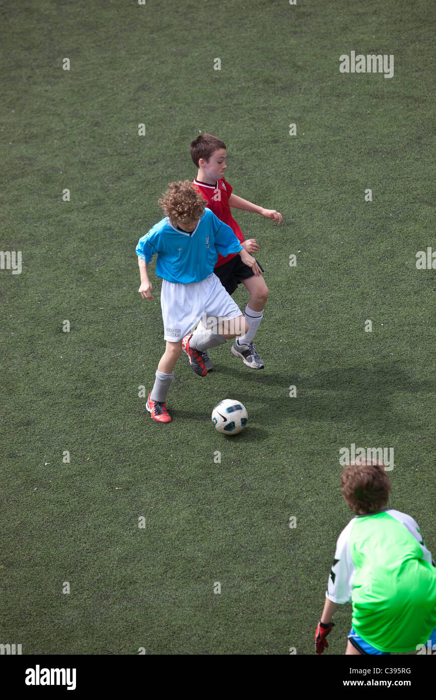 Boy's soccer game action. - Stock Image