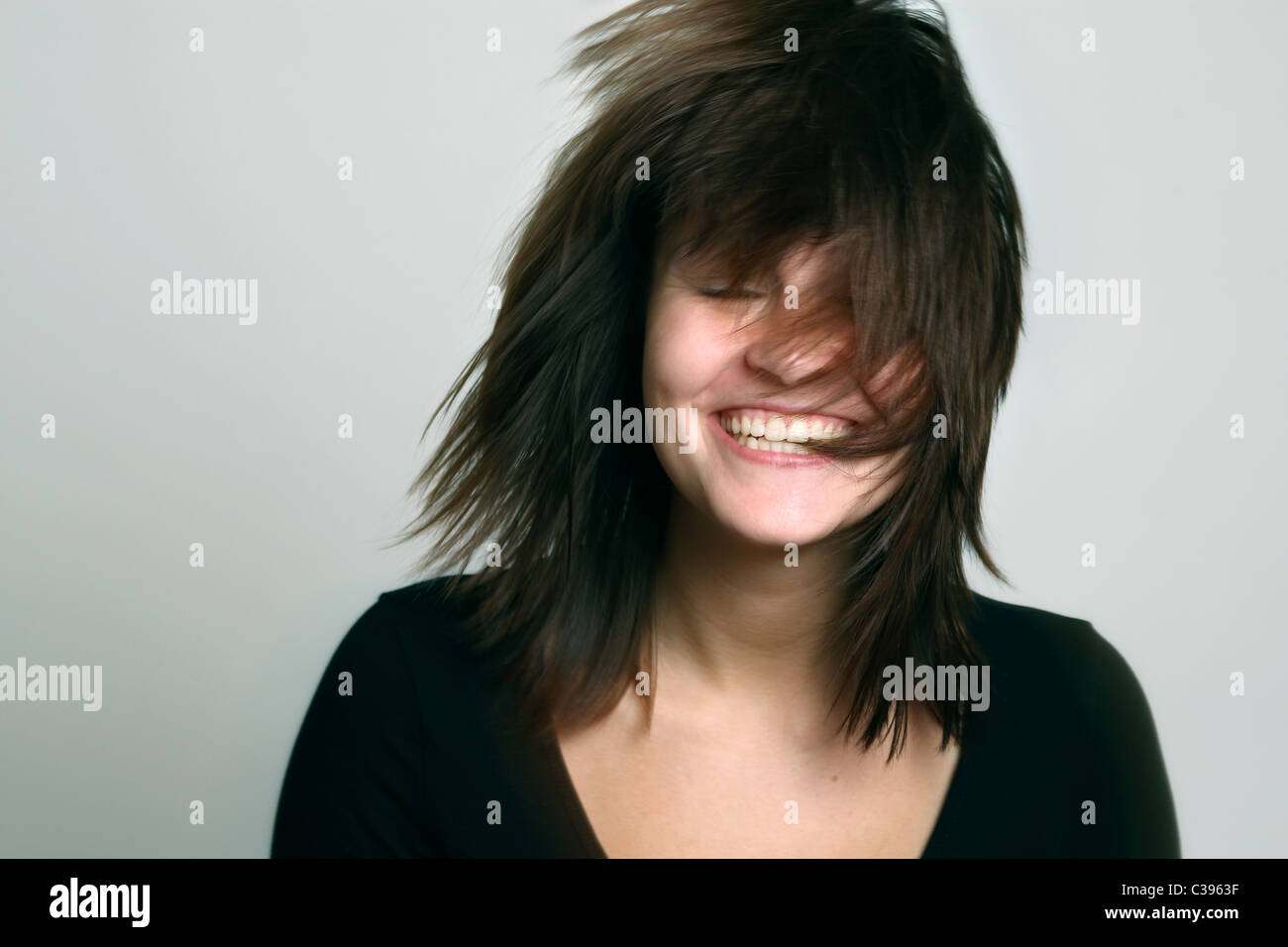 A woman laughing cheerfully - Stock Image
