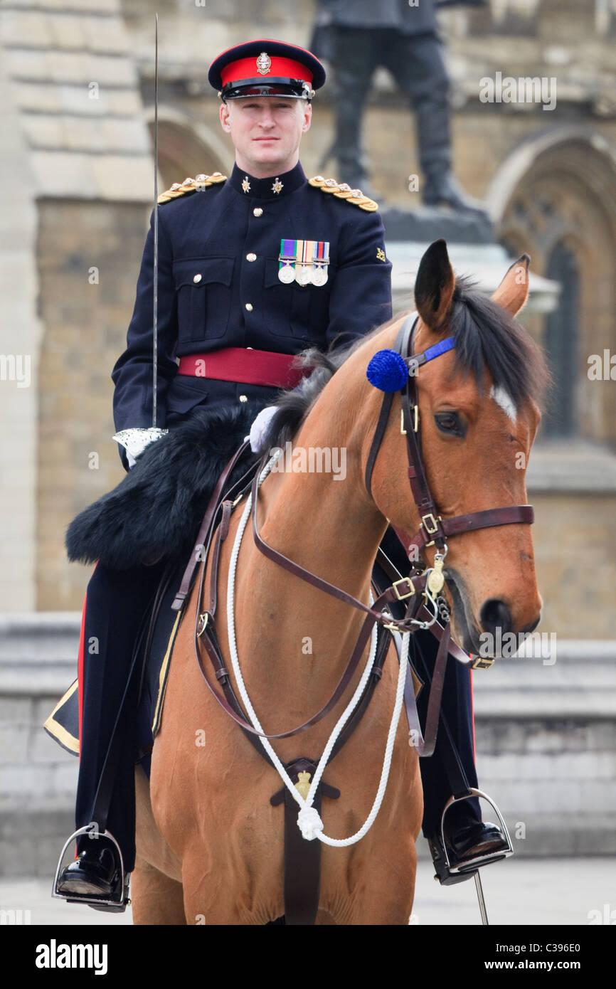 British Army Officer Captain riding a horse on official ceremonial duty guarding route of royal wedding of William - Stock Image