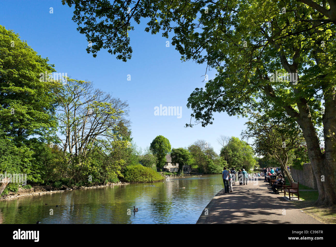 The banks of the River Wye in the village of Bakewell on the early May Bank Holiday weekend, The Peak District, - Stock Image