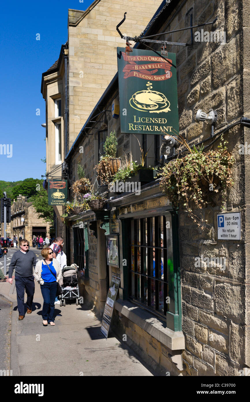 Tourists on the pavement ouside The Old Original Bakewell Pudding Shop, Bakewell, The Peak District, Derbyshire, - Stock Image