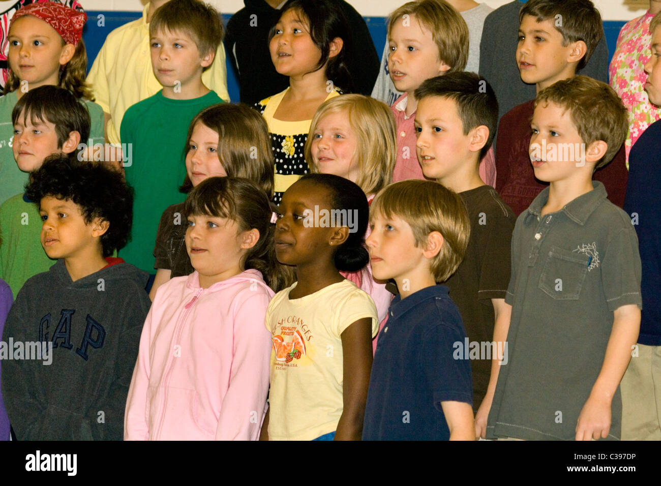 Racially mixed elementary school children chorus singing. St Paul Minnesota MN USA - Stock Image