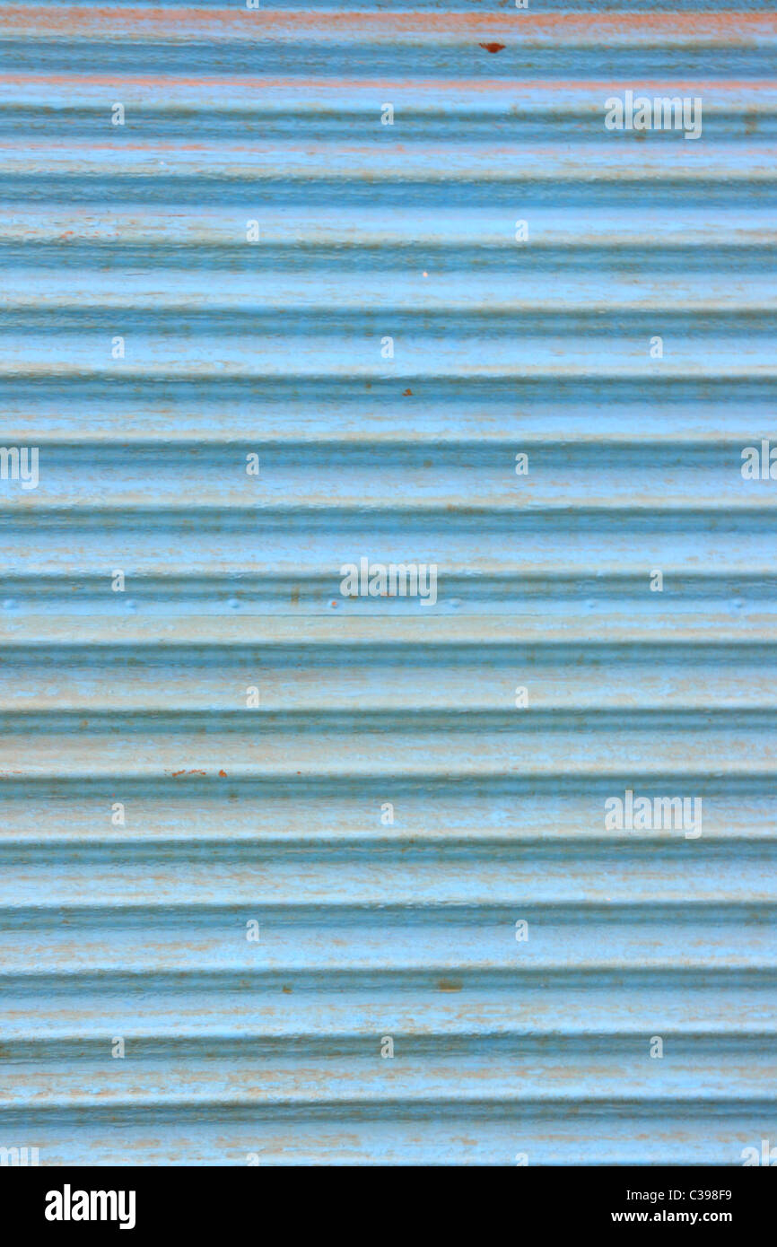 Old rusty blue corrugated iron plate texture detail - Stock Image