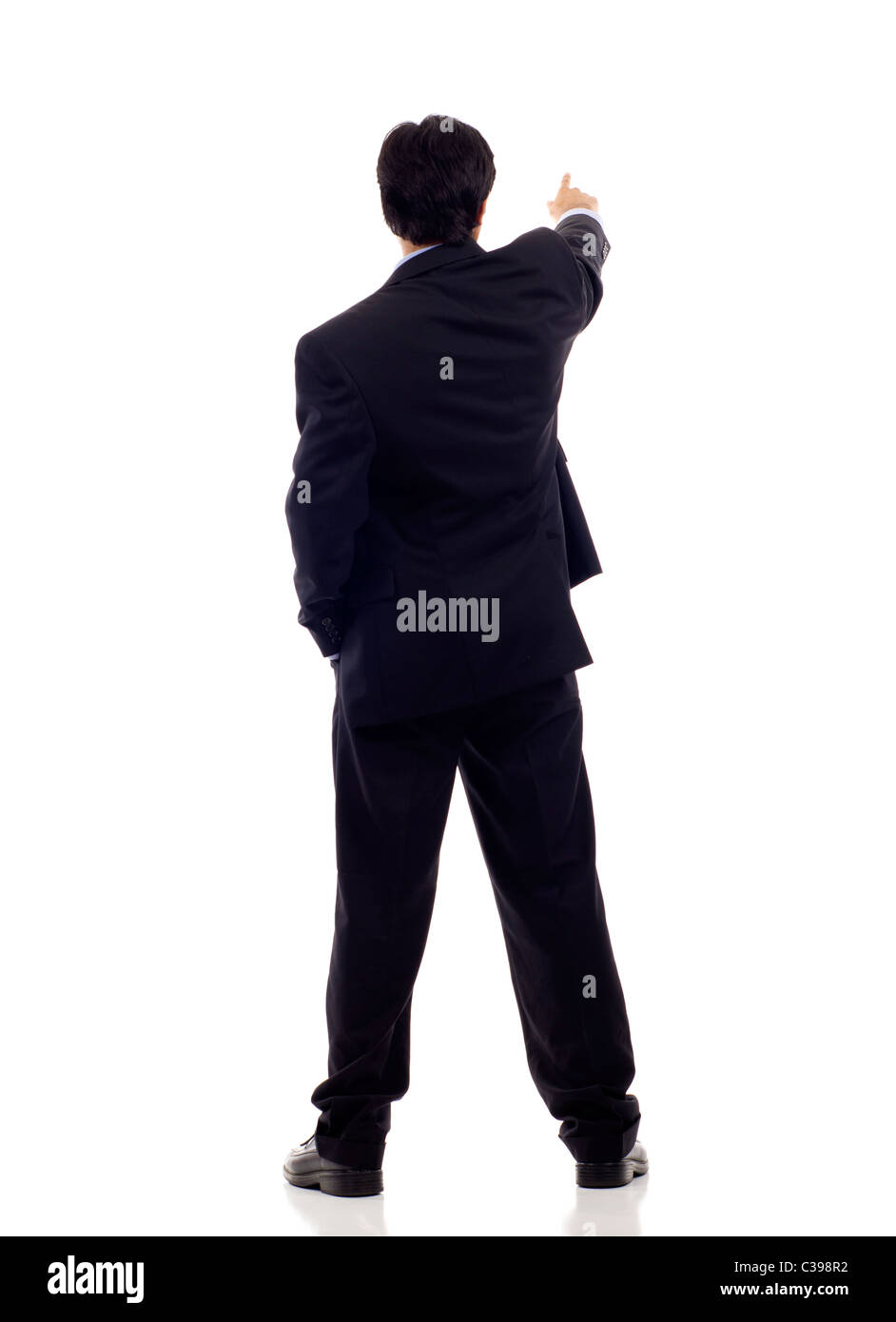 Back view of a businessman pointing isolated over white background - Stock Image