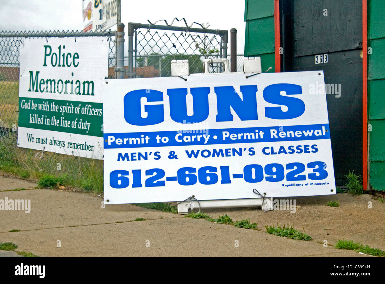 Signs for police Memoriam and classes for permits to carry guns. St Paul Minnesota MN USA - Stock Image