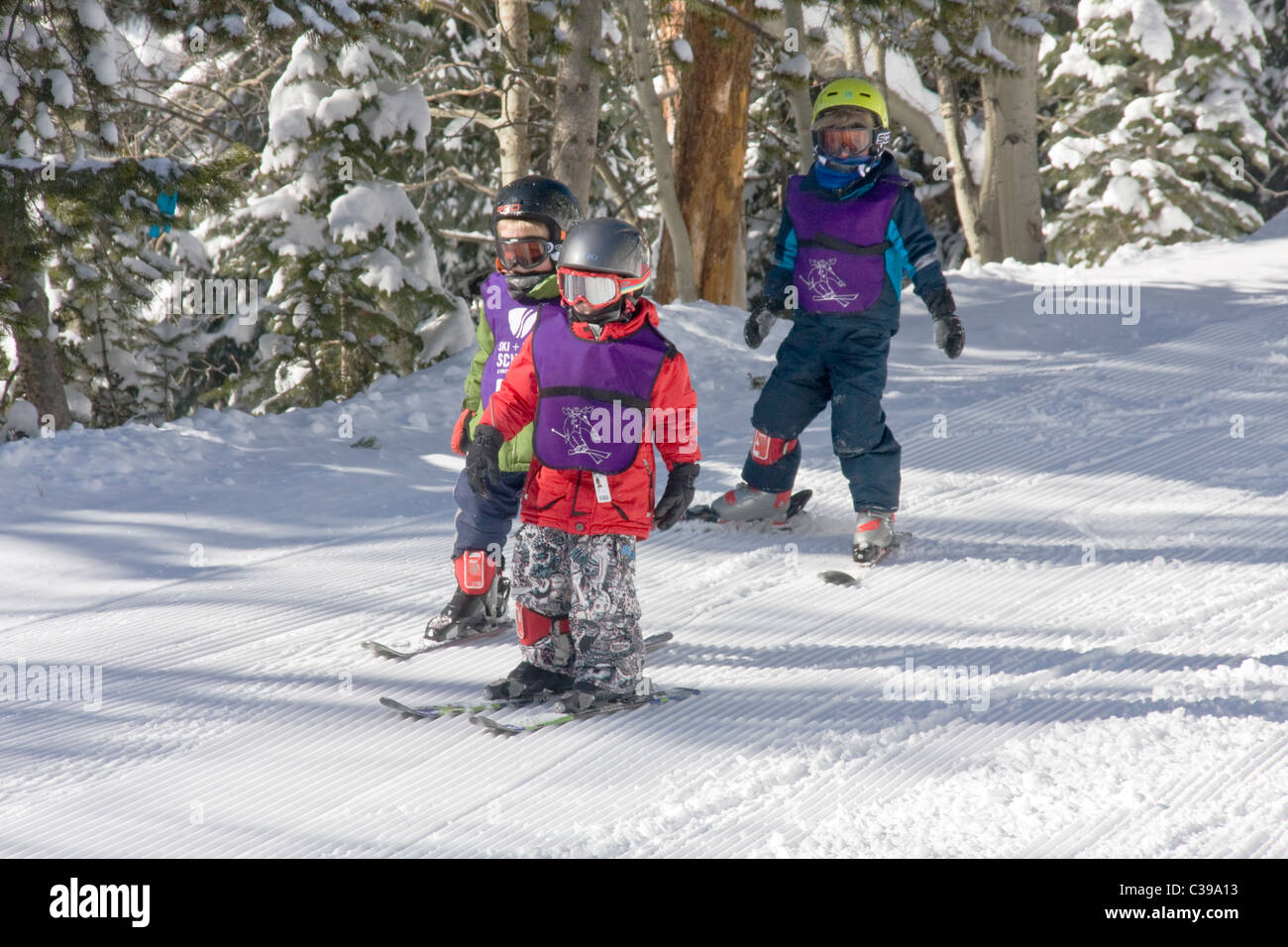 kids ski school instructor and students, winter park resort stock