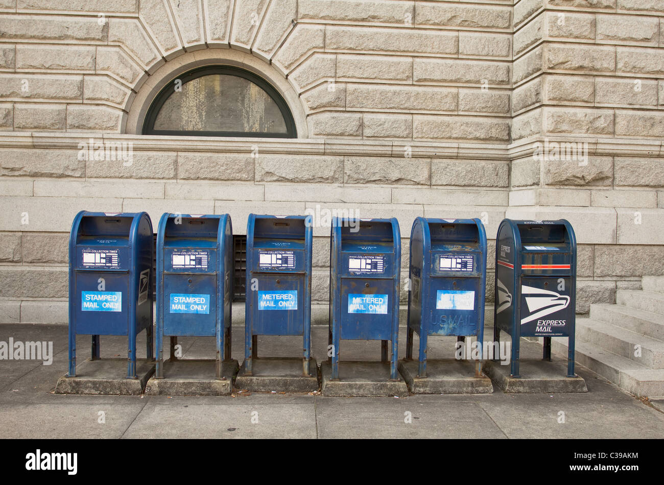 Row of blue mailboxes outside the U.S. Post Office and Courthouse in Charleston South Carolina - Stock Image