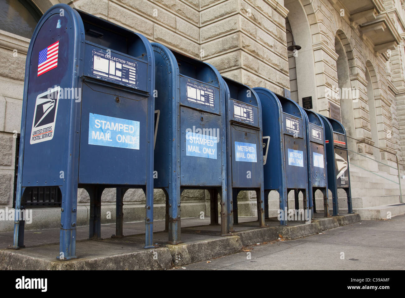 Row of blue mailboxes outside the U.S. Post Office and Courthouse in Charleston South Carolina Stock Photo