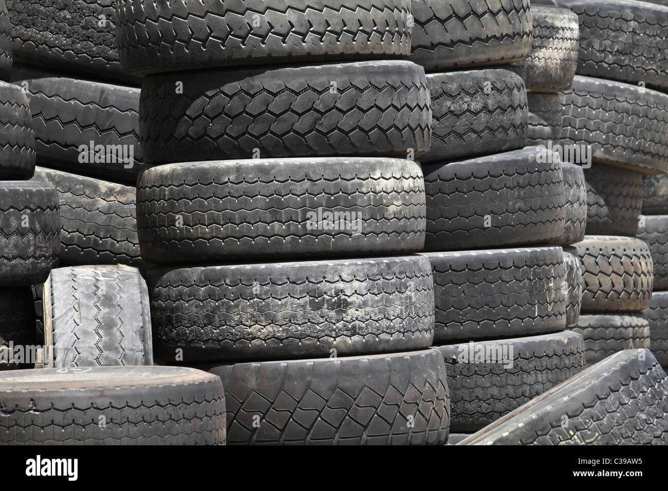 Stacks of old truck tires - Stock Image